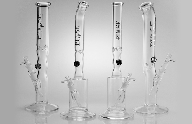 Four Double Showerhead Nanos by Pulse glass stand side by side on a white background.