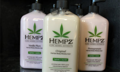 Three full bottles of Hempz lotion.