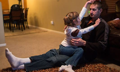 Mark Botker plays with daughter Greta, 7, at their new Colorado home. Greta joined a migration of parents who, after trying countless methods to ease their children's crippling seizures, are packing up their families and moving to Colorado.