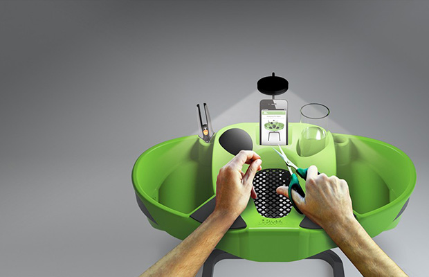 Green Trim Station with a light, drink holders, two catch alls on either side and a grate at the front.
