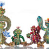 Four glass bears modeled after cacti stand next to one another in Unparalleled Glass' studios.